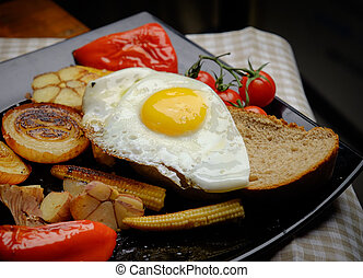 Fried eggs on bread. Plate of grilled vegetables.