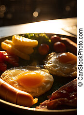 fried eggs, sausages and vegetable with sunlight in the morning , american breakfast