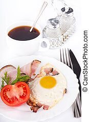 Fried eggs with bacon and tomatoes, a cup of coffee, a nourishing breakfast