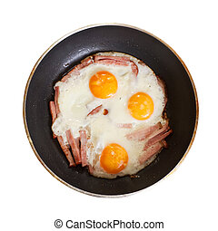 fried eggs with bacon skillet. Isolated over white