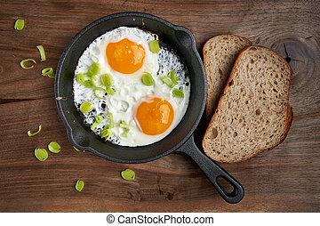 Fried eggs with bread breakfast