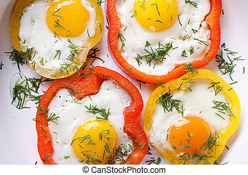fried eggs with peppers macro. horizontal top view