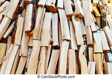 fried firewood background - Chopped pine firewood pile...