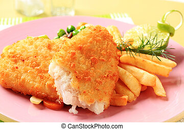 Fried fish served with French fries and mixed vegetables