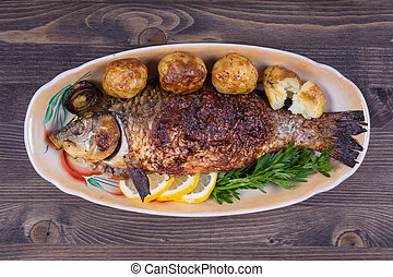 Fried fish carp on the plate