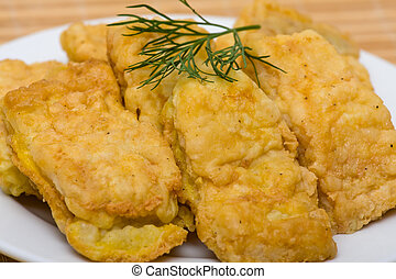 Fried fish fillet in white plate