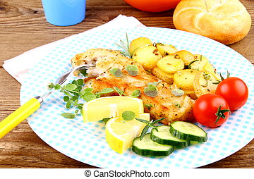 Fried fish fillet with rosemary potatoes and vegetables