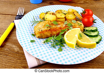 Fried fish fillet with rosemary potatoes, vegetables