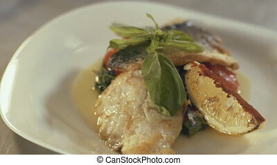 Fried fish fillet with vegetables close up. - Fish dish -...