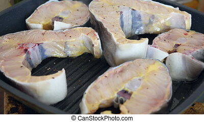 Fried fish steaks in pan