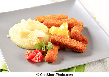 Fried fish sticks with mashed potato