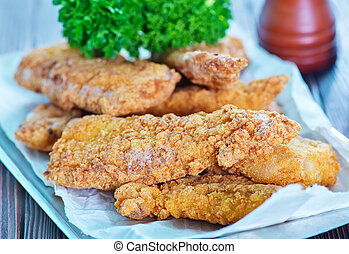 fried fish on tray and on a table