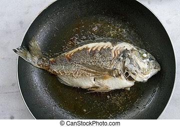 fried fish - whole fried Gilthead seabream fish (Dourada) on...