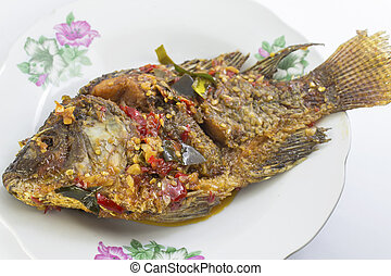 fried fish with fresh herbs