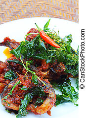 fried fish with herbs and sweet spicy sauce