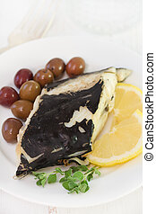 fried fish with olives and lemon