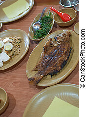 Fried fish with other asian dishes
