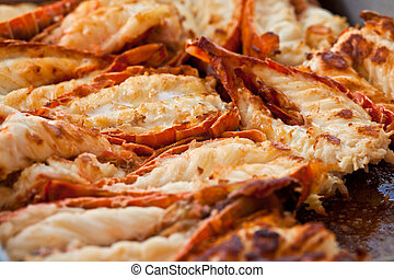 Fried lobsters in a pan on a plate