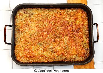 Meat Casserole - fried Meat Casserole a pan in a cafe
