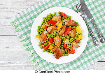 fried meat chunks with green peas