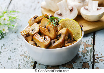fried mushrooms champignons in a bo
