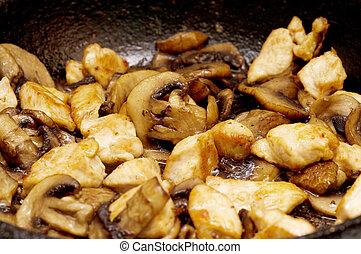 fried mushrooms in a pan closeup