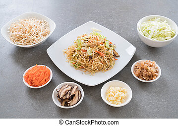 fried noodles on plate with ingredients