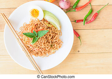 fried noodles with chilli on wood table