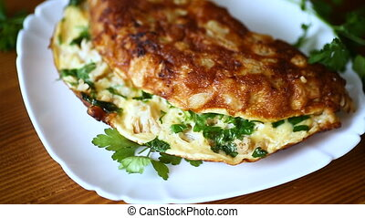 fried omelet with cauliflower and greens in a plate on a...