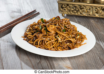 Fried Penang Char Kuey Teow which is a popular noodle dish in Ma