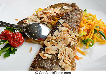 Fried pieces of fish on a white plate.