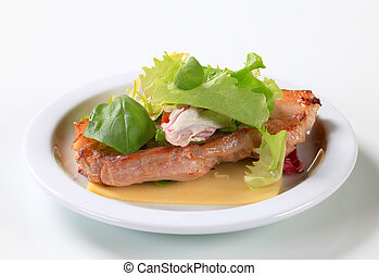 Fried pork belly with leaf vegetables