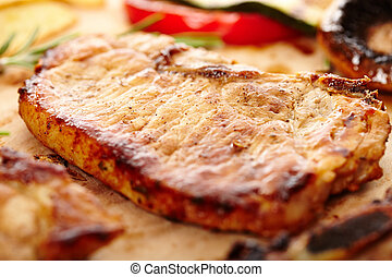 Fried pork chop on a wooden board
