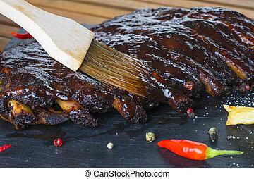 fried pork ribs on stone plate - fried pork ribs on plate