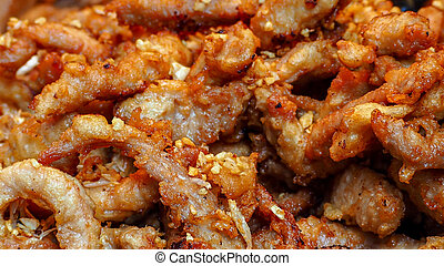 Fried pork with garlic fried. Asian food. Thai cuisine. Closeup dried chopped pork fried. Breakfast or lunch appetizer food in Thailand. Street food. Protein and fat source. Delicious recipes.