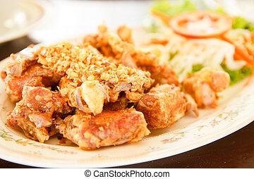 Fried pork with garlic.