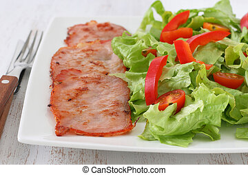 fried pork with salad