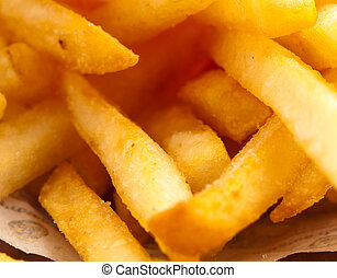 fried potato chips closeup, extreme closeup photo
