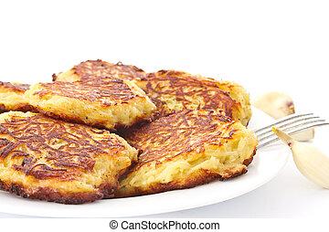 potato pancakes - fried potato pancakes on a plate on a ...