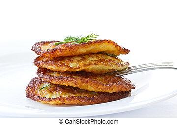 potato pancakes - fried potato pancakes with dill on white ...