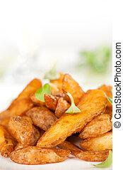 Fried potato wedges closeup