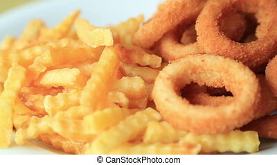 Fried potatoes and onion rings