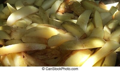 Fried potatoes in a frying pan close-up