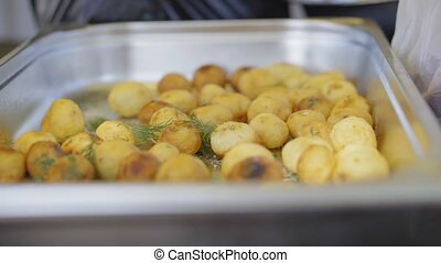 fried potatoes on a large baking sheet, soft focus