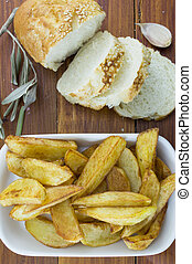 Fried potatoes on a plate decorated with sliced bread