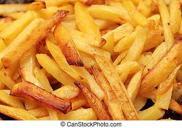 fried potatoes - yellow background as fried potatoes