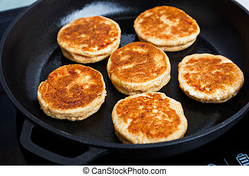 Fried Quark Pancakes - Delicious fried syrniki close-up....