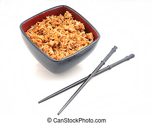 Fried rice in red bowl with chopsticks