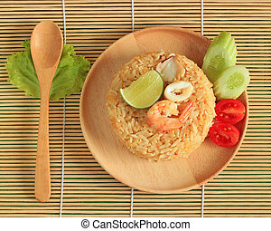 fried rice with shrimp and squid served on a plate