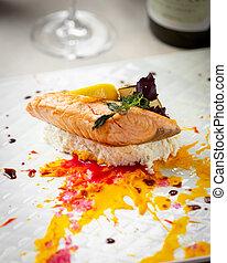 Fried salmon with lemon and basil